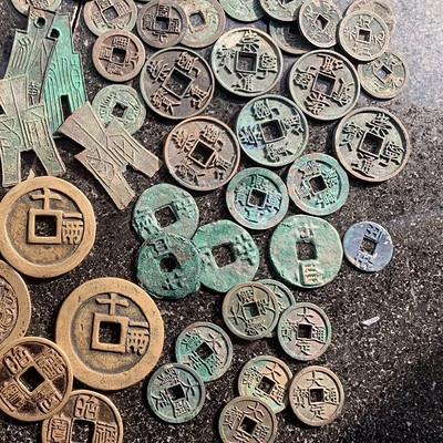 古钱币收藏文化智圆形方鉴赏